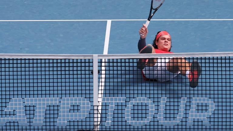 Top 5 Photos 2/2:  Raonic takes plunge  for Team Canada