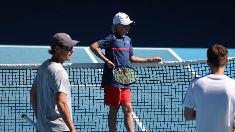 Lleyton and his son, Cruz—a notable tennis player himself—at the 2021 Australian Open.