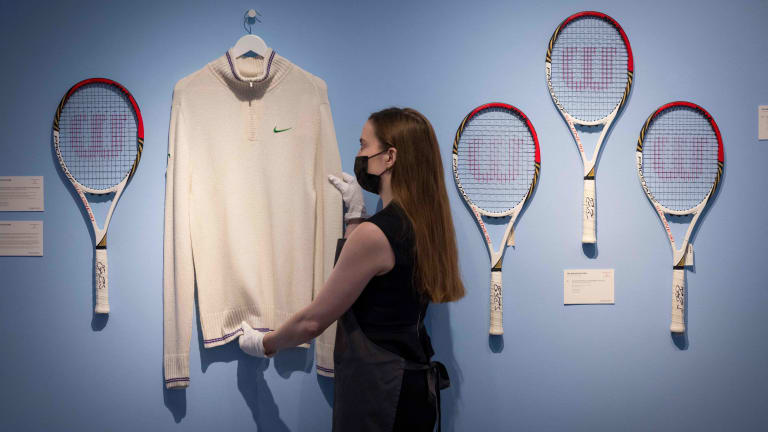 Some of the Swiss' title-winning apparel was auctioned at Christie's London, to benefit the Roger Federer's Foundation. (Photos from June 21, via Getty Images.)