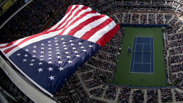 A bird's-eye view of Arthur Ashe Stadium in 2016, fifteen years after 9/11.