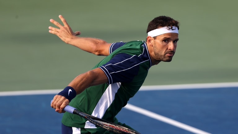 When in doubt, Dimitrov knifed a low slice, forcing the seven-footer to bend down and hit up on the ball.
