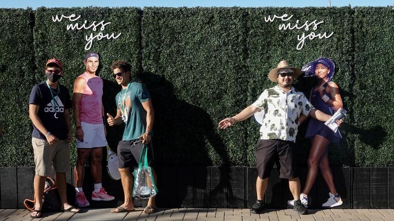 Fans snap photos with Nadal and Osaka life-size cutouts.