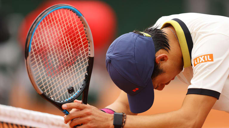 Healthy Nishikori quietly outlasts Evans in five-set rollercoaster