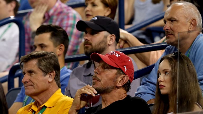 Pasarell takes in the BNP Paribas Open action alongside current owner Larry Ellison.