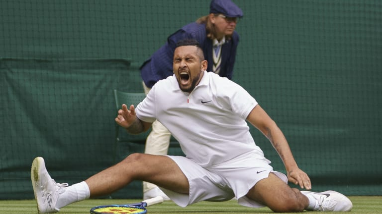 Nick Kyrgios reacts after slipping on No. 1 Court in the fifth set of his match against Ugo Humbert. The Aussie would continue and win the decider, 9-7.