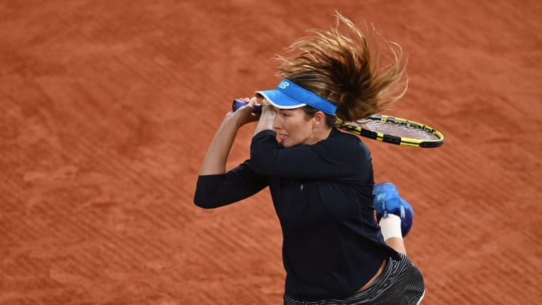 Collins digs deep to oust Muguruza in late night at Roland Garros