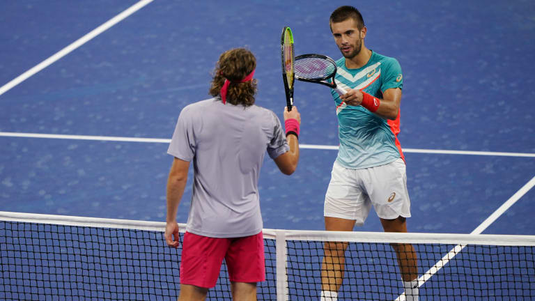 Coric saves six match points and wins a silent classic over Tsitsipas