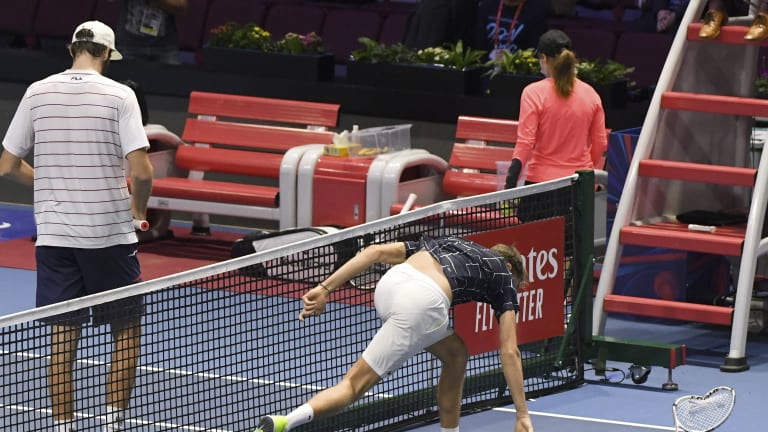 AP Images: Medvedev destroys his racquet after losing to Opelka in St. Petersburg