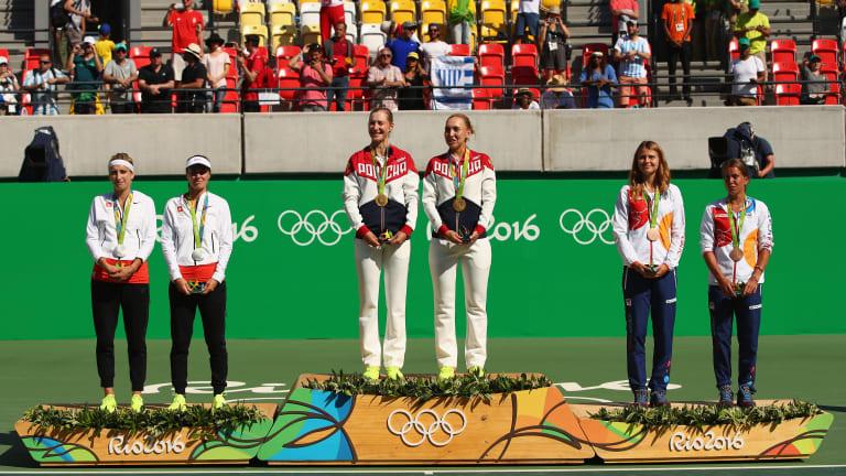 Elena Vesnina celebrates first victory since motherhood in Doha