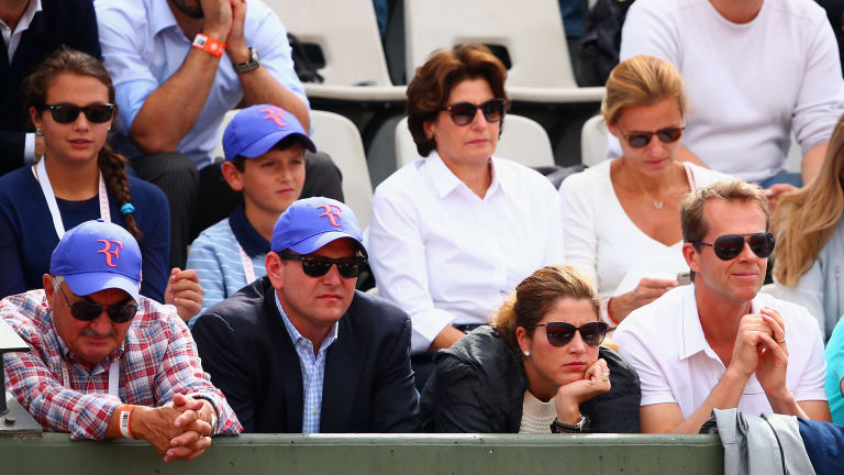 """Federer's agent has """"front row seat to history"""" but stays on the move"""