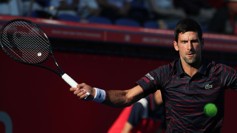 Djokovic cruises on Tokyo debut in first singles match since US Open