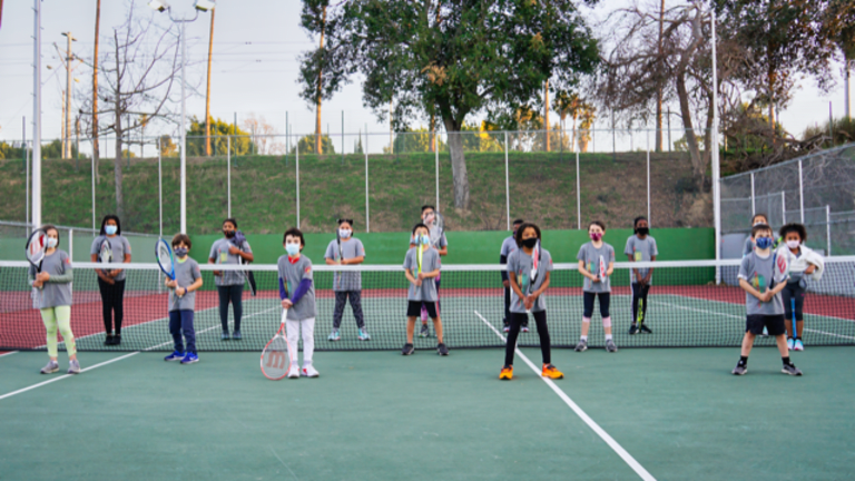 Children practice during a 40 Love clinic.