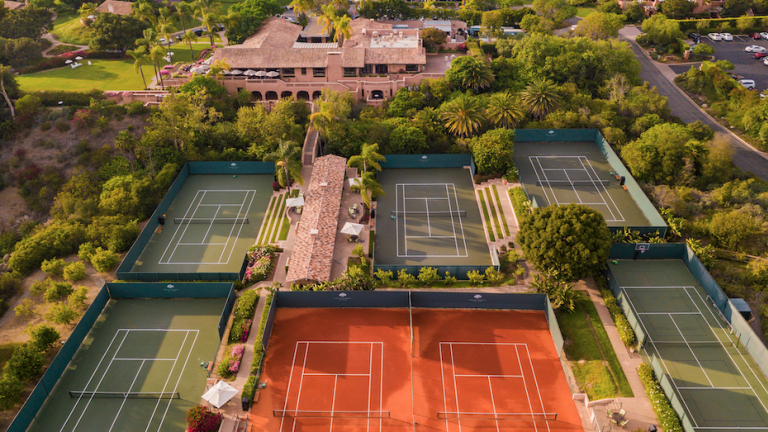Rancho Valencia's tennis center is surrounded by bougainvillea and orange groves.